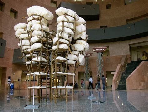Considering Brian Zimmerman's stacked-chair sculpture